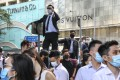 Masked anti-government protesters hold a lunchtime rally in Central. Photo: K.Y. Cheng