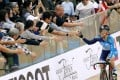 Sarah Lee high fives fans after winning the keiren at a World Cup leg at Tseung Kwan O velodrome in January. Photo: Felix Wong
