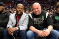 Floyd Mayweather Jnr sits with Dana White at an NBA game between the Los Angeles Clippers and the Boston Celtics. Photo: Instagram