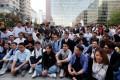 Pan-democratic winners gather outside Hong Kong Polytechnic University (PolyU) in Hung Hom on November 25. Photo: Reuters