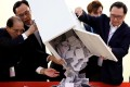 Officials open a ballot box at a polling station in Kowloon Tong in Hong Kong on Sunday. Photo: Reuters