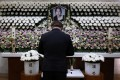 A man pays tribute at a memorial altar in honour of the K-pop star Goo Hara at St Mary's Hospital in Seoul. Photo: Reuters
