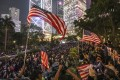 Anti-government protesters wave US flags during a demonstration in Central in October to urge the US Congress to pass the Hong Kong Human Rights and Democracy Act. Photo: Felix Wong