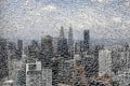 The Kuala Lumpur skyline, as seen through a cracked glass pane. Photo: Bloomberg