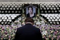 A man pays tribute at a memorial altar as he makes a call of condolence in honour of the K-pop star Goo Hara at the Seoul St. Mary's Hospital in Seoul, South Korea, on Monday. Photo: Reuters