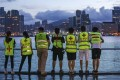Volunteer first aid workers look across the harbour at the Tsim Sha Tsui skyline after a protest outside the government headquarters in Admiralty on June 18. Hong Kong has the least affordable housing in the world. Photo: Dickson Lee