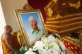 A Thai Buddhist monk walks past the coffin of former Communist Party of Malaysia leader Chin Peng in 2013. Photo: EPA