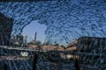 The ICC (International Commerce Centre) is seen in the distance through damaged glass at Hong Kong Polytechnic University. The campus became the focal point of some of the worst violence in more than five months of anti-government protests. Photo: AFP