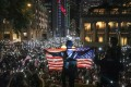 Anti-government protesters wave a US flag during a rally at Chater Garden in Central on October 14, as they urge the US Congress to pass the Hong Kong Human Rights and Democracy Act. Photo: Felix Wong