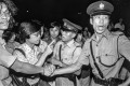 Members of the press confront police during a June 1979 riot by Vietnamese refugees at the Kai Tak camp. Photo: SCMP
