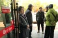 Elderly depositors seek information about the safety of their savings at a branch of Yingkou Coastal Bank in Yingkou, Liaoning province, on November 8. China's cuts in lending rates to shore up a slowing economy have put more pressure on small banks like Yingkou. Photo: Reuters