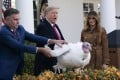 """US President Donald Trump pardons a turkey named """"Butter"""" in a Thanksgiving ceremony on November 26, with farmer Wellie Jackson, who raised the bird, and First Lady Melania Trump. Photo: EPA-EFE"""