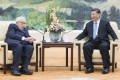 Chinese President Xi Jinping chats to former US secretary of state Henry Kissinger in Beijing last week. Photo: Xinhua
