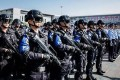 More than 1,000 police officers took part in the anti-terror drill in Zhuhai. Photo: Toutiao