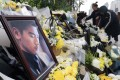 Fans lay floral tributes to Godfrey Gao in the east China city of Ningbo. Photo: DPA