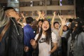 Pro-democracy supporters celebrate on November 25, a day after Hongkongers turned out in force to give opposition candidates a landslide win at the district council elections. Photo: AP