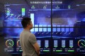 A man looks at the screen display at data Centre at Beijing Peony Electronic Group in May 2019. Photo: Simon Song