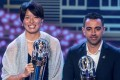 Japan and Olympique Lyonnais star Saki Kumagai (left) wins AFC women's player of the year and poses with Al Sadd SC coach Xavi Hernandez, who receives the men's player of the year award on behalf of Akram Afif. Photo: AFP