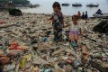 Children on a heavily polluted beach in Bali, Indonesia. A team of Hong Kong students has invented a cheap robot that can collect plastic from the sea and reduced the scourge of marine pollution. Photo: Riau Images/Barcroft Images via Getty Images