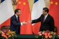 French President Emmanuel Macron shakes hands with Chinese President Xi Jinping following a signing ceremony at the Great Hall of the People in Beijing on November 6. Photo: AFP