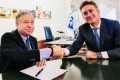 FIA chief Jean Todt and Formula E boss Alejandro Agag shake hands after signing the world championship agreement in Paris. Photo: FIA
