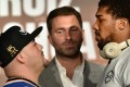 Andy Ruiz Jnr (left) and Anthony Joshua (right) face each other, as promoter Eddie Hearn (centre) looks on. Photo: AFP