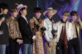 Members of the band BTS receive the award for best music video for the single Boy with Luv, at the Asian Music Awards in Nagoya, Japan, on Wednesday, December 4. But who looked the slickest onstage? Photo: AP