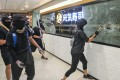 Protesters vandalise a restaurant operated by Maxim's Caterers at a shopping mall in Sha Tin on October 7. The group was targeted after the founder's daughter denounced the protests and disruptions. Photo: Sam Tsang