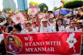 People rally in Yangon in support of Myanmar State Counsellor Aung San Suu Kyi before she heads off to the International Court of Justice (ICJ). Photo: Reuters