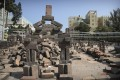 A mock tomb stands amid barricades built by protesters near Baptist University in Kowloon Tong on November 15. Photo: AP