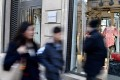 Pedestrians walk past a Lanvin shop on the Rue du Faubourg Saint-Honore in Paris. Fosun bought the ailing French fashion label with a promise to revive its fortunes. Photo: AFP
