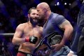 Jorge Masvidal is awarded the 'BMF' belt by Dwayne 'The Rock' Johnson after his victory by TKO on a medical stoppage against Nate Diaz at UFC 244. Photo: AFP