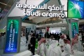 Visitors gather at Saudi Aramco's booth during the Abu Dhabi International Petroleum Exhibition and Conference in Abu Dhabi, on November 11, 2019. Photo: EPA-EFE