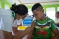 A boy receives a vaccine during a nationwide campaign against measles in Samoa. Photo: Unicef/AFP