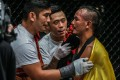 Martin Nguyen (centre) congratulates Tial Thang (right) with Aung La N Sang. Photo: One Championship