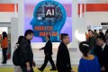 Visitors walk past a stand with artificial intelligence cameras at the 14th China International Exhibition on Public Safety and Security in Beijing on October 24. Photo: Agence France-Presse
