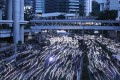 Hong Kong protesters used their smartphones to create a streaming flow of light in the streets. Photo: Sam Tsang