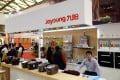 JS Global showcases its Joyoung product range during the Appliance and Electronics World Expo in Shanghai, China in March 2015. Photo: Imaginechina