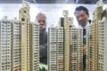 Potential homebuyers on Monday inspect a scale model at the Housing Authority in Lok Fu. Photo: Dickson Lee