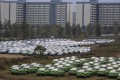 Cars stand ready for delivery at BYD's electric car factory in Xian, Shaanxi province. Sales of new-energy vehicles fell 42 per cent to 78,000 units last month. Photo: EPA-EFE