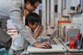 Zhou Ziheng began teaching his son Vita how to write codes when he was five. Photo: AFP
