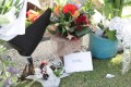 Floral tributes to the volcano's victims lie at the port in Tauranga, where the cruise ship Ovation of the Seas is berthed. Photo: EPA