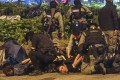 Anti-government protesters are arrested while trying to escape from Polytechnic University. Photo: Sam Tsang