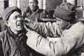 A dentist in China performs a tooth extraction in the 1920s.