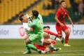 Hong Kong goalkeeper Yapp Hung-fai gets in a tangle with a South Korea player during their match at the EAFF Championship in Busan. Photo: Reuters