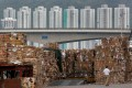 Tonnes of waste paper to be shipped to China are piled up at a dock in Hong Kong in September 2017. Photo: Reuters