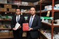 Customs divisional commander Jacky Tsang (left) and Guy Fong display some of the seized counterfeit drugs. Photo: Xiaomei Chen