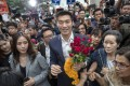 Thanathorn Juangroongruangkit, leader of the antimilitary Future Forward Party, surrounded by his supporters. Photo: AP Photo