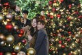 People take selfies at Lee Tung Avenue in Wan Chai on Christmas Eve in 2018. This year, let us enjoy the thrill of thrift as our common Christmas gift. Photo: Sam Tsang
