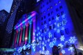The New York Stock Exchange facade lit up with festive cheer. Wall Street had a good day on Thursday. Photo: AFP